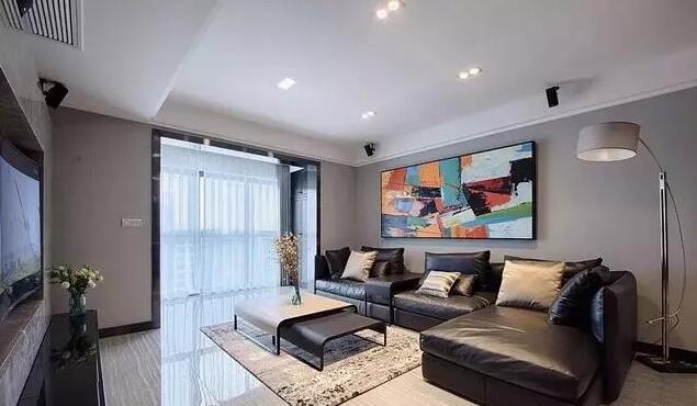 现代简约风格装修效果图,客厅真皮沙发撞色挂画个性十足
